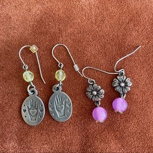 Two pairs pf silver toned drop earrings